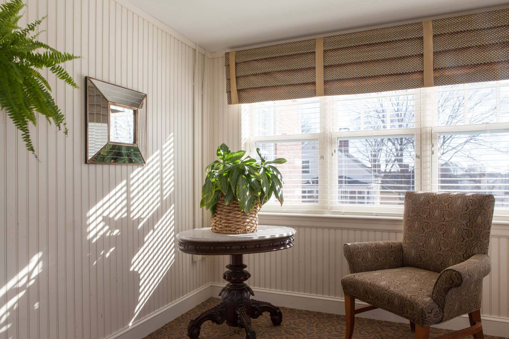 Seating by window in sunroom