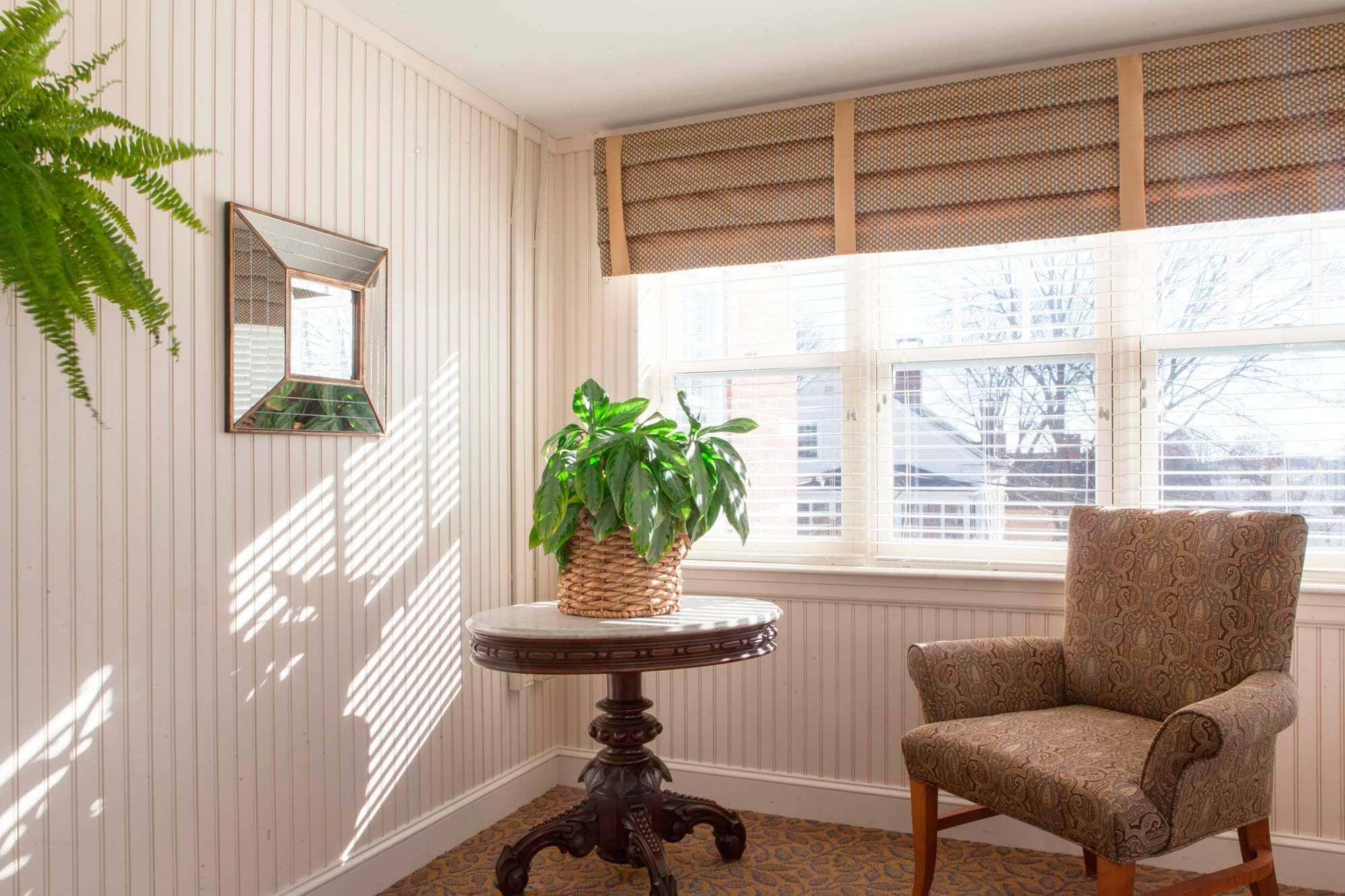 Looking towards a cozy nook in the sun room
