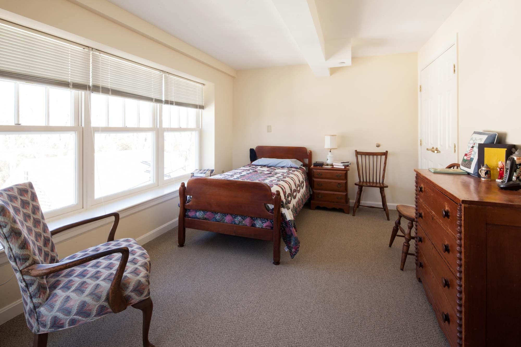 View of private bedroom in a one bedroom living space